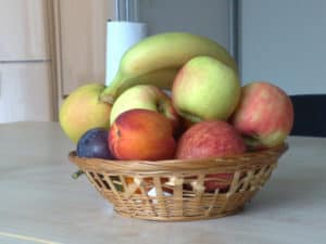 Basket of fruit in the style of a still life painting