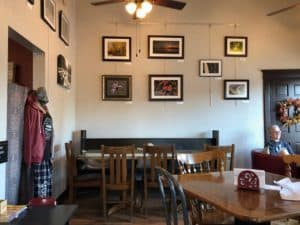 Coffee shop with local art displayed on the walls