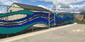Chain link fence made into a mural of a stream