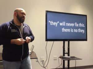 "Carlos Moreno presents a slide saying, ""They will never fix it. There is no they."""